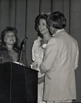 Being interviewed by emcees Dick Sweeney and Kim Christensen, Miss Colorado 1982